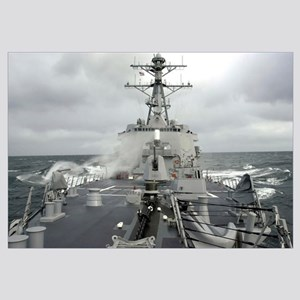 Sea spray whips across the deck of the USS Winston