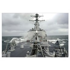 Sea spray whips across the deck of the USS Winston Framed Print