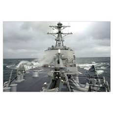 Sea spray whips across the deck of the USS Winston Poster