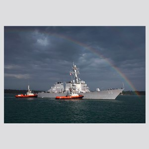 A rainbow arches over the guided missile destroyer