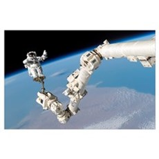 Astronaut anchored to a foot restraint on the Inte Poster