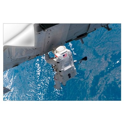 Astronaut traverses along the station hardware on Wall Decal
