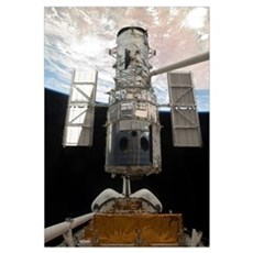 The Hubble Space Telescope is released from the ca Poster