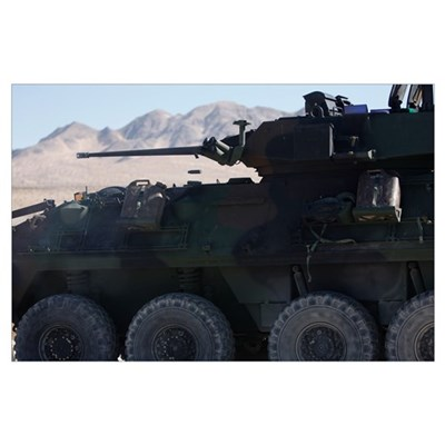 A light armored vehicle fires its 25mm Bushmaster Poster