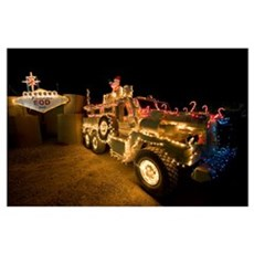 Cougar MRAP is adorned in holiday lights parked in Poster