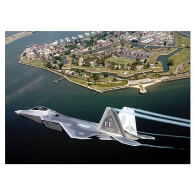 A F/A 22 Raptor flies over Fort Monroe Poster