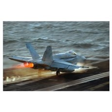 An F/A18C Hornet launches from the flight deck of  Poster