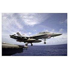 An F/A18F Super Hornet launches from the flight de Poster