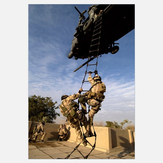 Air Force pararescuemen are extracted by an HH60G