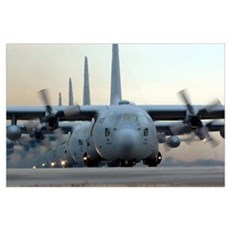 C130 Hercules aircraft taxi out for a mission duri Poster