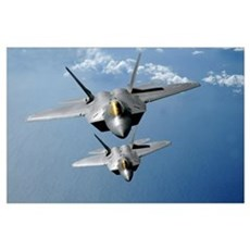 Two F22 Raptors fly over the Pacific Ocean Poster