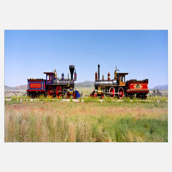 Two steam engines on a railroad track, Jupiter and