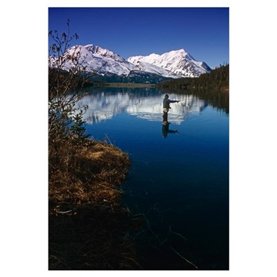 Fisherman casts his line in reflecting water Framed Print