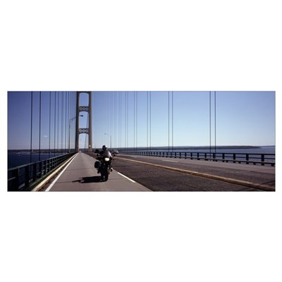 Person riding a motorcycle on a bridge Mackinac Br Poster