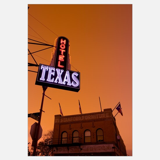 Low angle view of a neon sign of a hotel lit up at