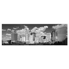Clouds over skyscrapers in a city, Charlotte, Nort Framed Print
