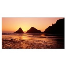 Silhouette of rocks at sunset, Heceta Head Lightho Framed Print
