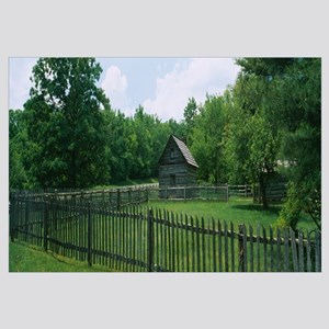 Log cabin surrounded by picket fence, Puckett Cabi