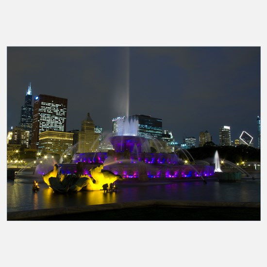 Illuminated fountain with skyscrapers in a city, B