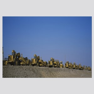 Row of bulldozers at a construction site