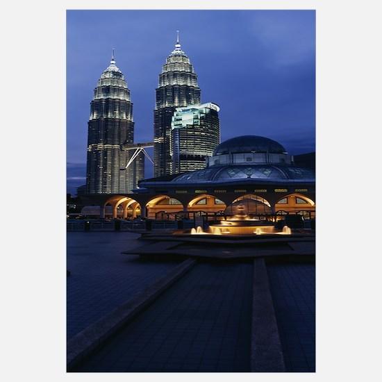 Twin towers lit up at dusk, Petronas Towers, Kuala
