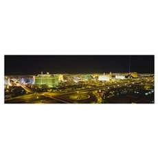 High angle view of buildings lit up at night, Las  Framed Print