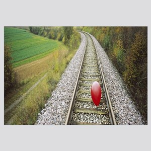 High Angle View Of A Balloon On A Railroad Track,