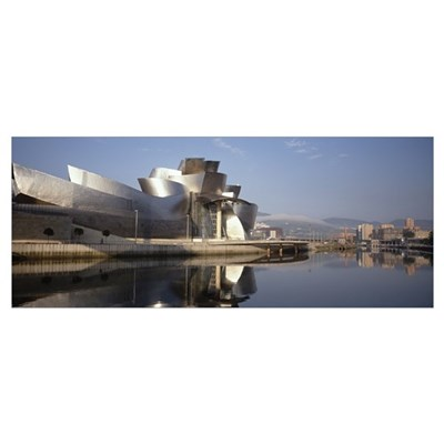 Reflection of a museum on water, Guggenheim Musuem Canvas Art