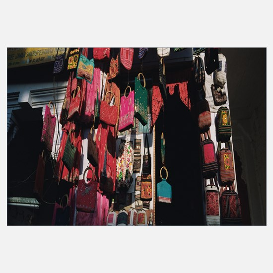 Low angle view of purses hanging in a store, Udaip