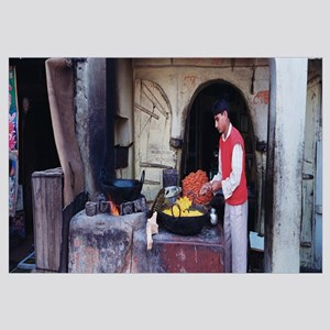 Side profile of a young man preparing sweet food,