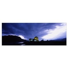 Low angle view of a castle lit up at dusk, Eilean  Poster