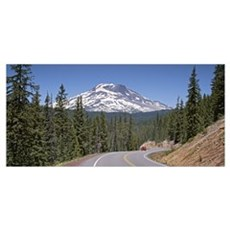 Vehicle moving on a road with South Sister Mountai Poster
