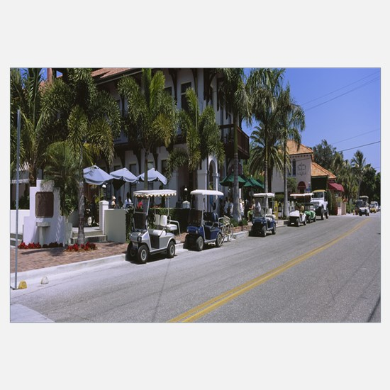 Golf carts and cars parked on a street, Boca Grand