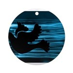 Black Dove Flying through Blu Ornament (Round)
