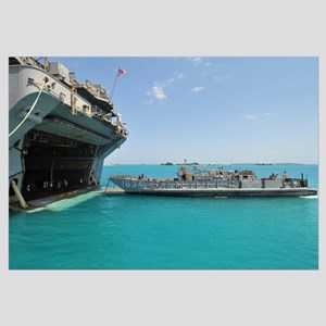 A landing craft utility approaches the well deck o