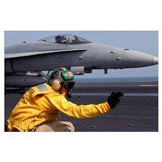 A shooter launches an F/A-18E Super Hornet from US Poster