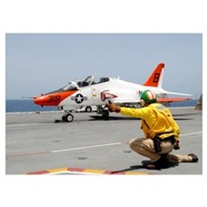 A shooter signlas the launch of a T-45A Goshawk tr Poster