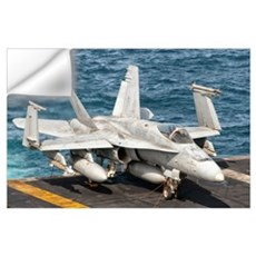 A US Navy F/A-18C Hornet tied on the flight deck o Wall Decal