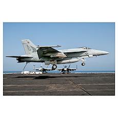 A US Navy F/A-18E Super Hornet prepares to land ab Poster