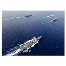 Aerial view of a naval fleet transiting the Pacifi Poster