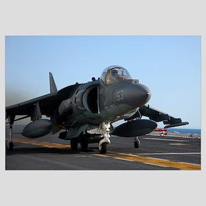 An AV-8B Harrier launches from the flight deck of