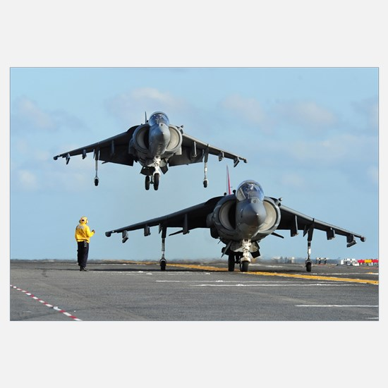 An AV-8B Harrier prepares for takeoff as another l