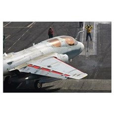 An EA-6B Prowler is guided onto a catapult aboard  Poster