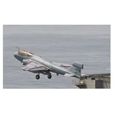 An EA-6B Prowler lifts off from the flight deck of Poster