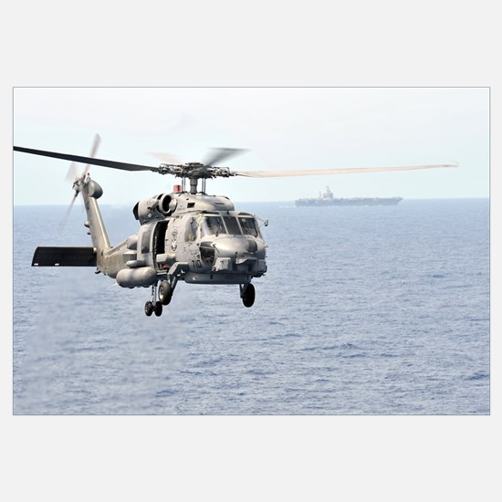 An MH-60R Seahawk helicopter in flight over the Pa