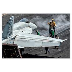 Flight deck crew position an F/A-18E Super Hornet  Poster