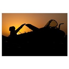 Silhouette of an EA-6B Prowler at sunrise on the f Poster