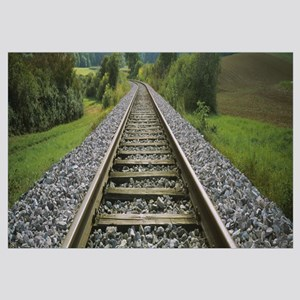 Railroad track passing through a landscape, German