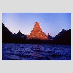 Silhouette of a mountain range at dawn, Sinopah Mo