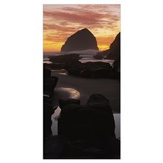Silhouette of rock formations on the beach, Haysta Poster